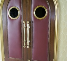 Arches upholstered leather door